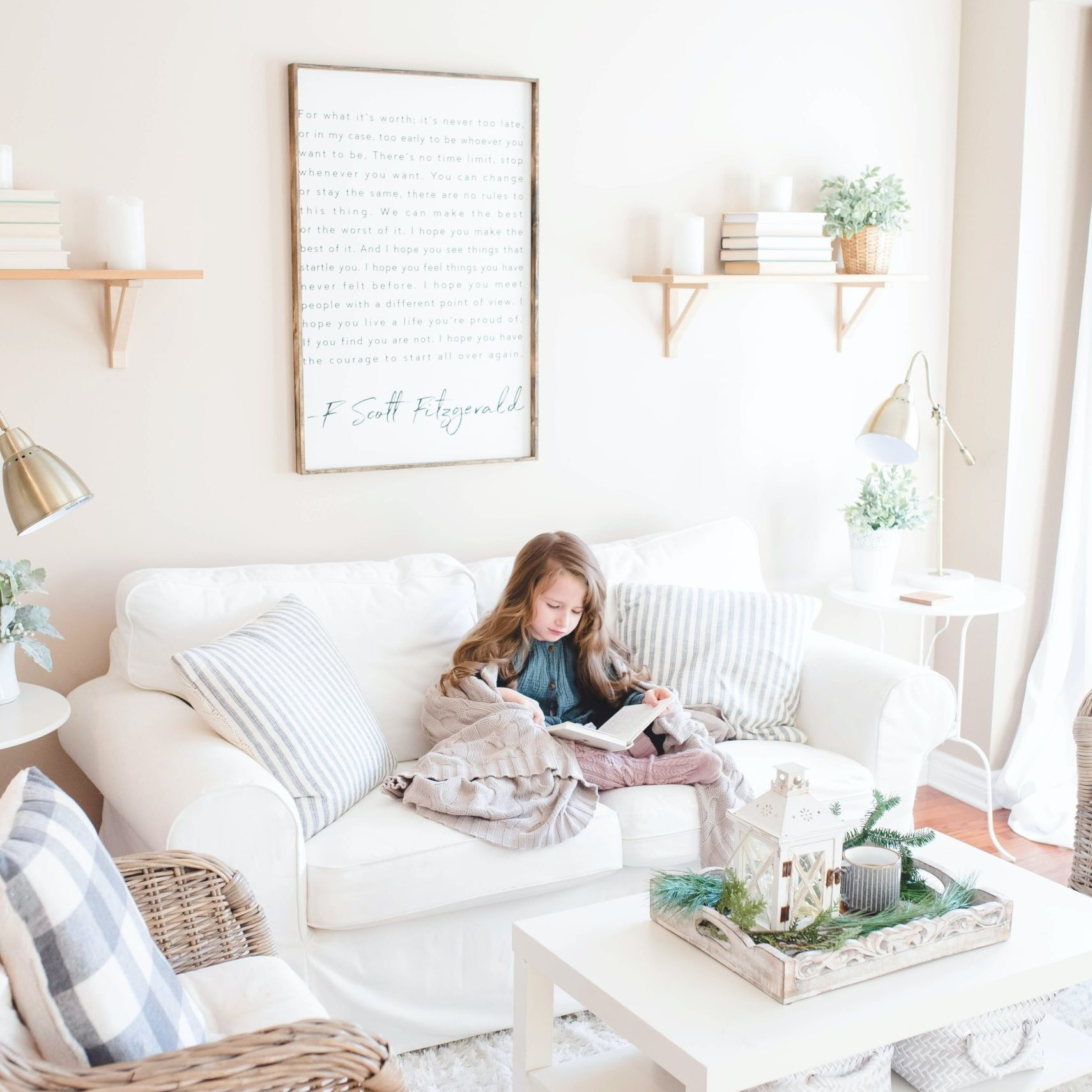 girl seated on sofa reading book